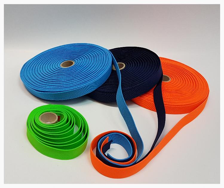 Niebieska, czarna, pomarańczowa i jasnozielona ozdobna guma odzieżowa